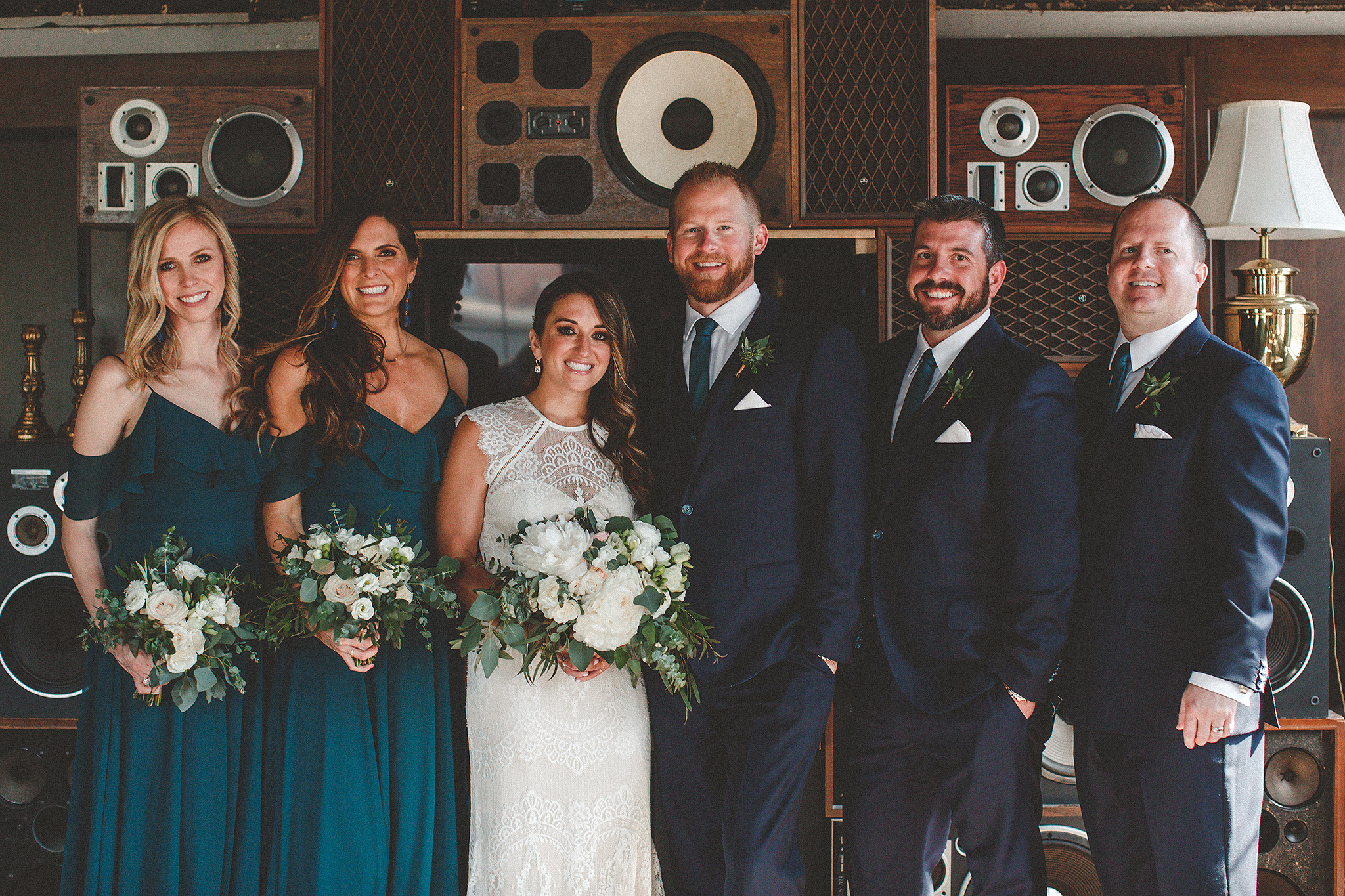 wedding party in front of vintage speaker wall | the ivy house milwaukee wedding photographer | chrissy deming
