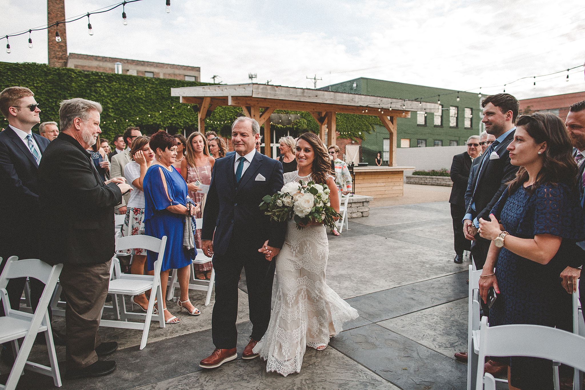 wedding ceremony must-haves | bride walking down aisle | the ivy house milwaukee wedding photographer