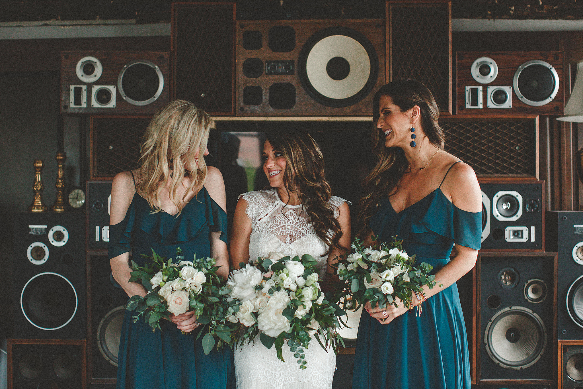 bride with bridesmaids in front of vintage speakers | the ivy house milwaukee wedding photographer | chrissy deming