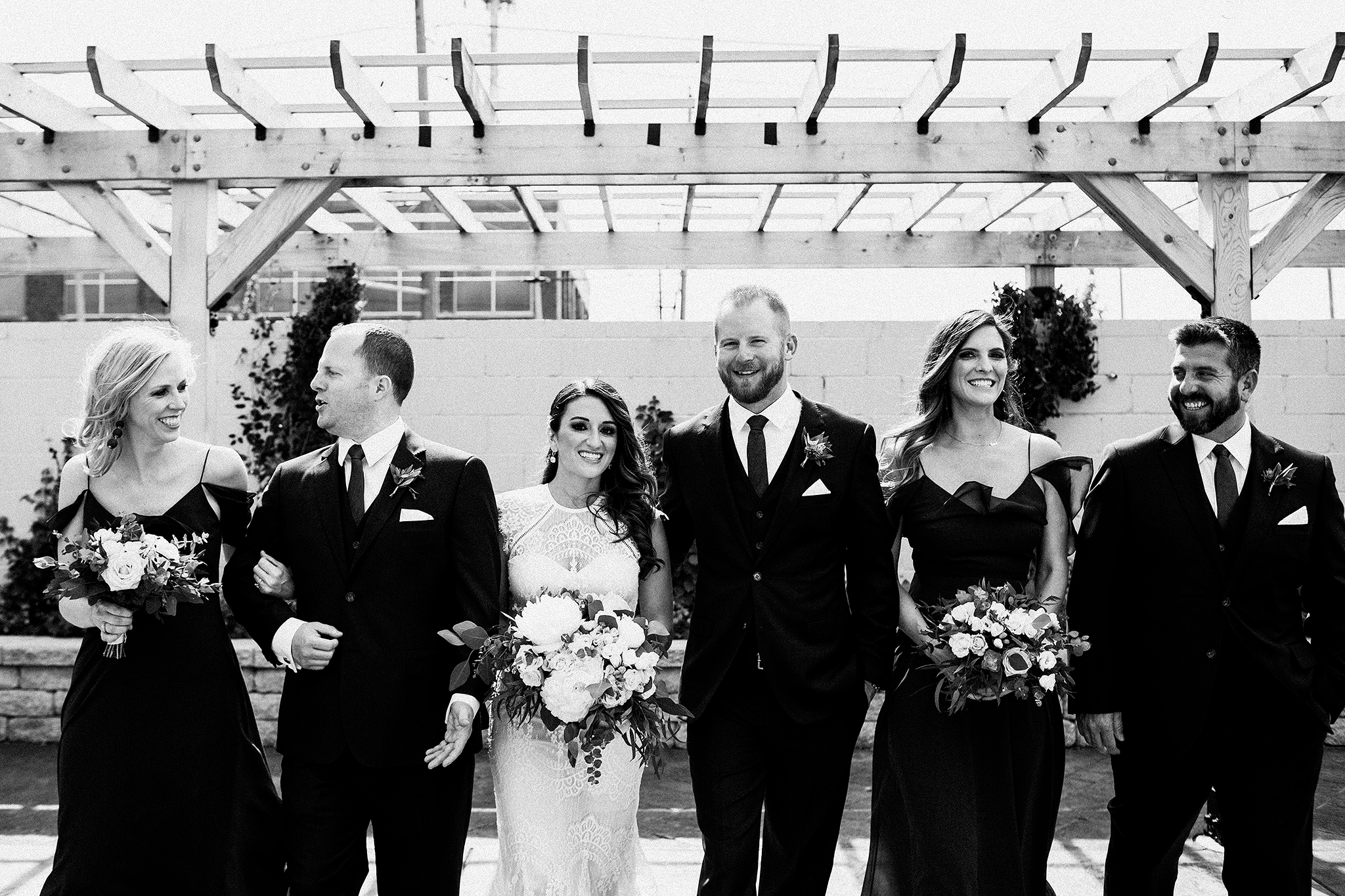 wedding party walking and laughing | the ivy house milwaukee wedding photographer | chrissy deming