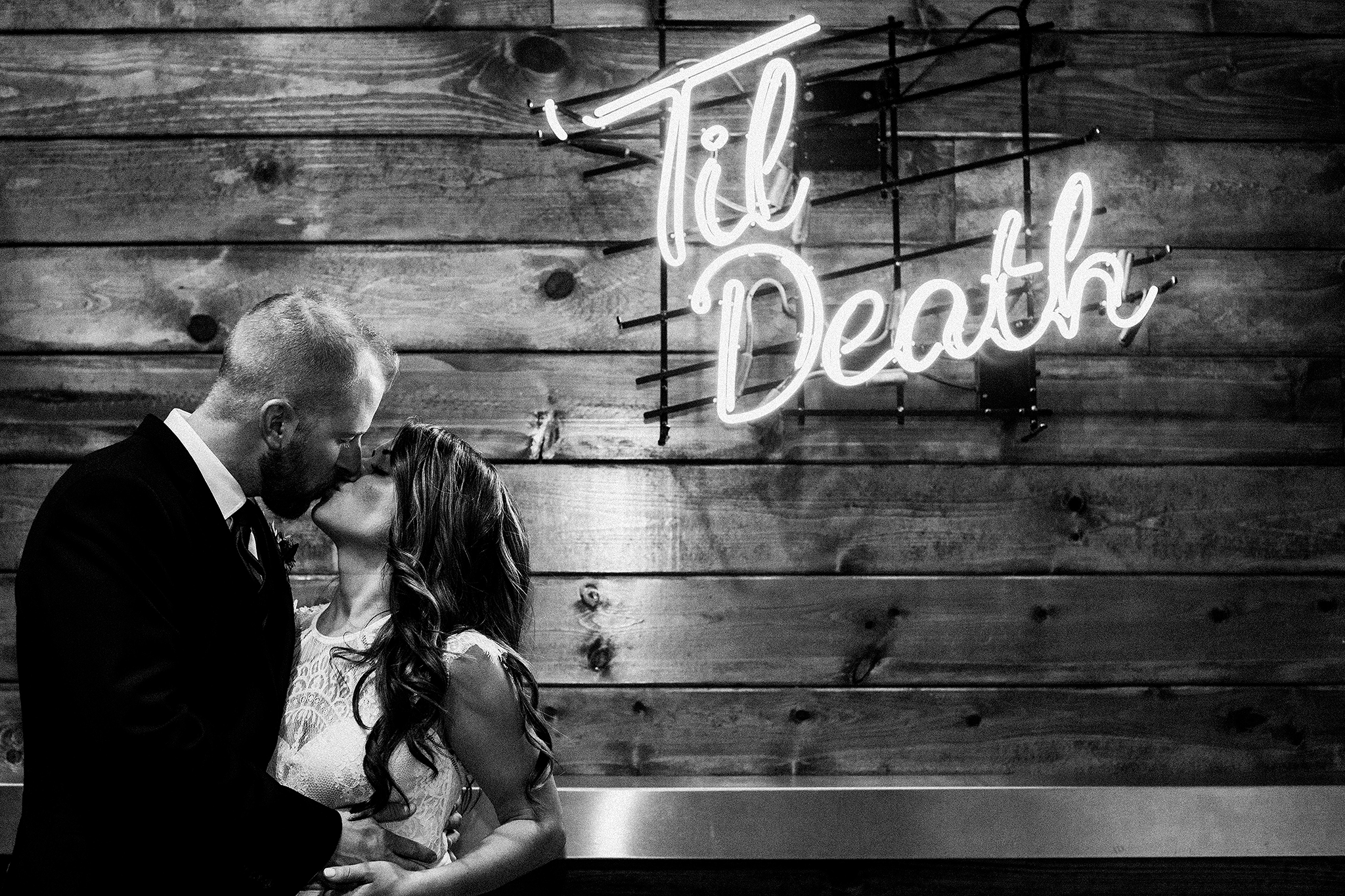 bride/groom photos with 'til death sign | the ivy house milwaukee wedding photographer | chrissy deming
