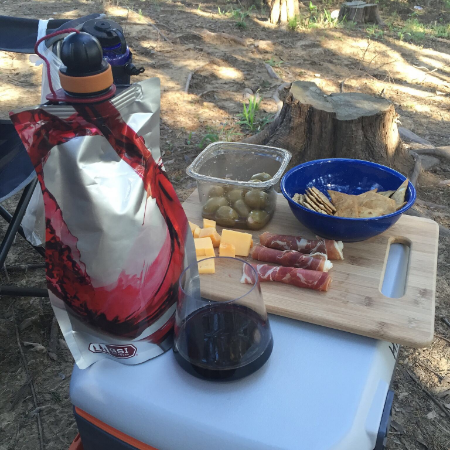 I also made it a point to pack cubes of gouda cheese (goes well with the Malbec I packed!), prosciutto and garlic-stuffed olives. Cheese and meat and olive board? This is how we camp. Lee smiled a lot as I made this.