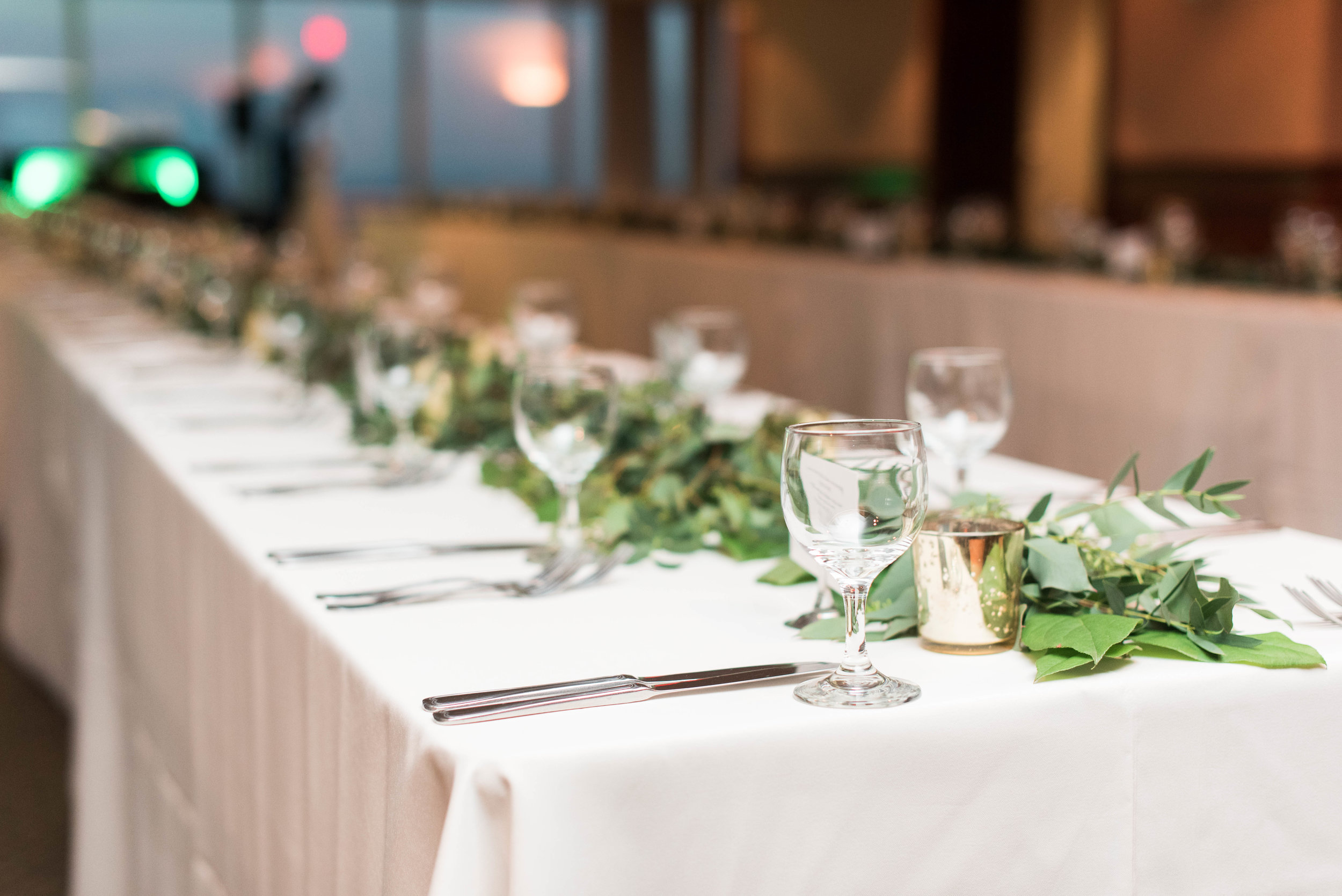 The tables were decorated down the center with garland and mercury glass votives.
