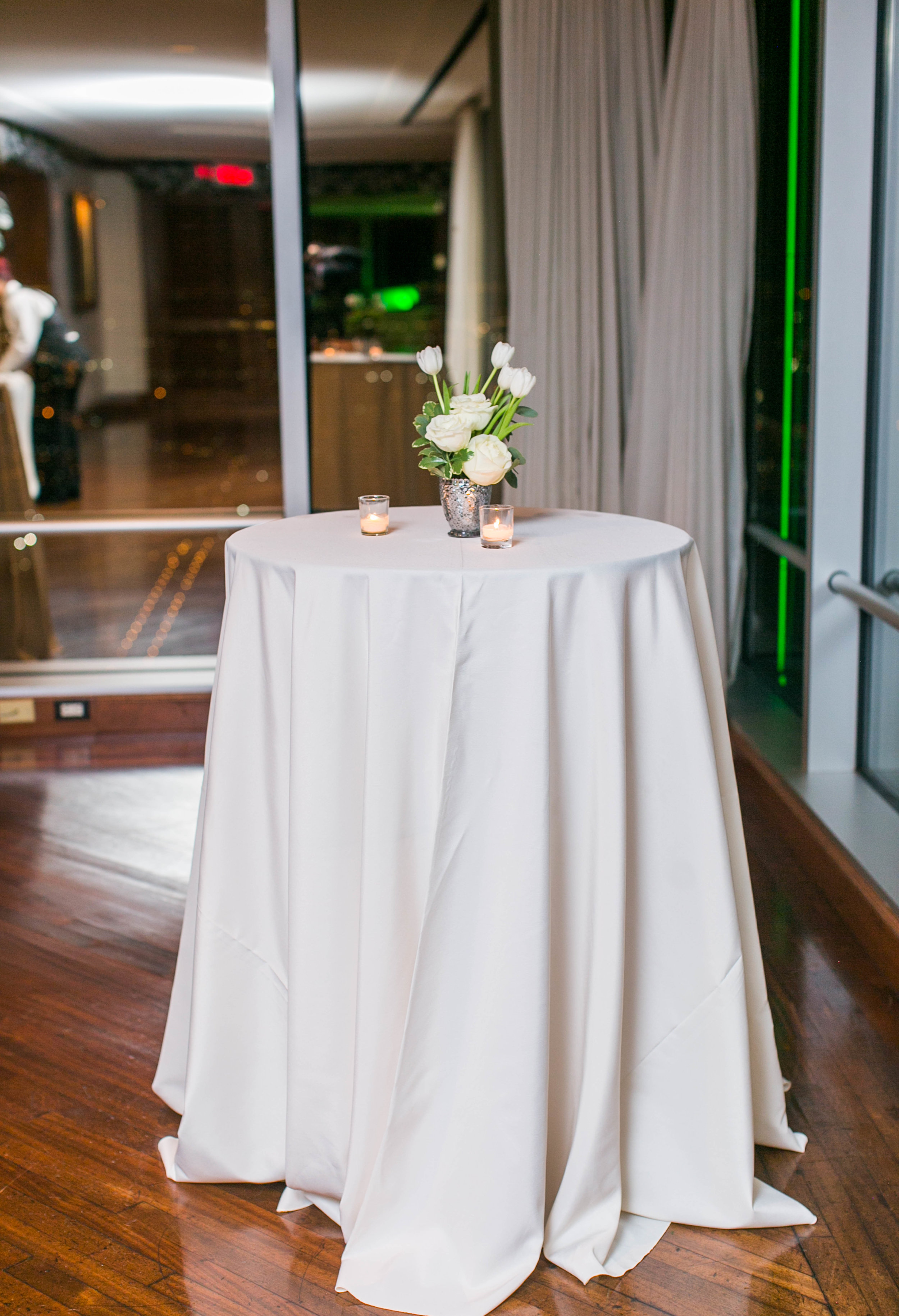 Our venue was on the 69th floor of a building in downtown Dallas, so we only had five of these high boy tables set up around the windows.