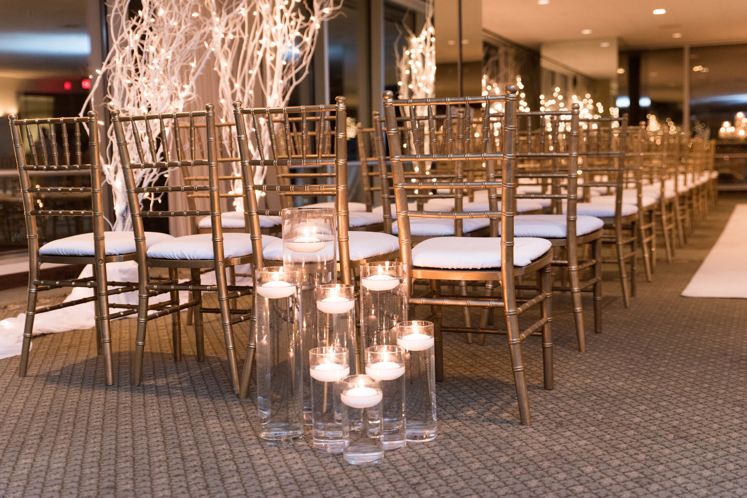 We kept things simple with floating candles flanking both sides the aisle.