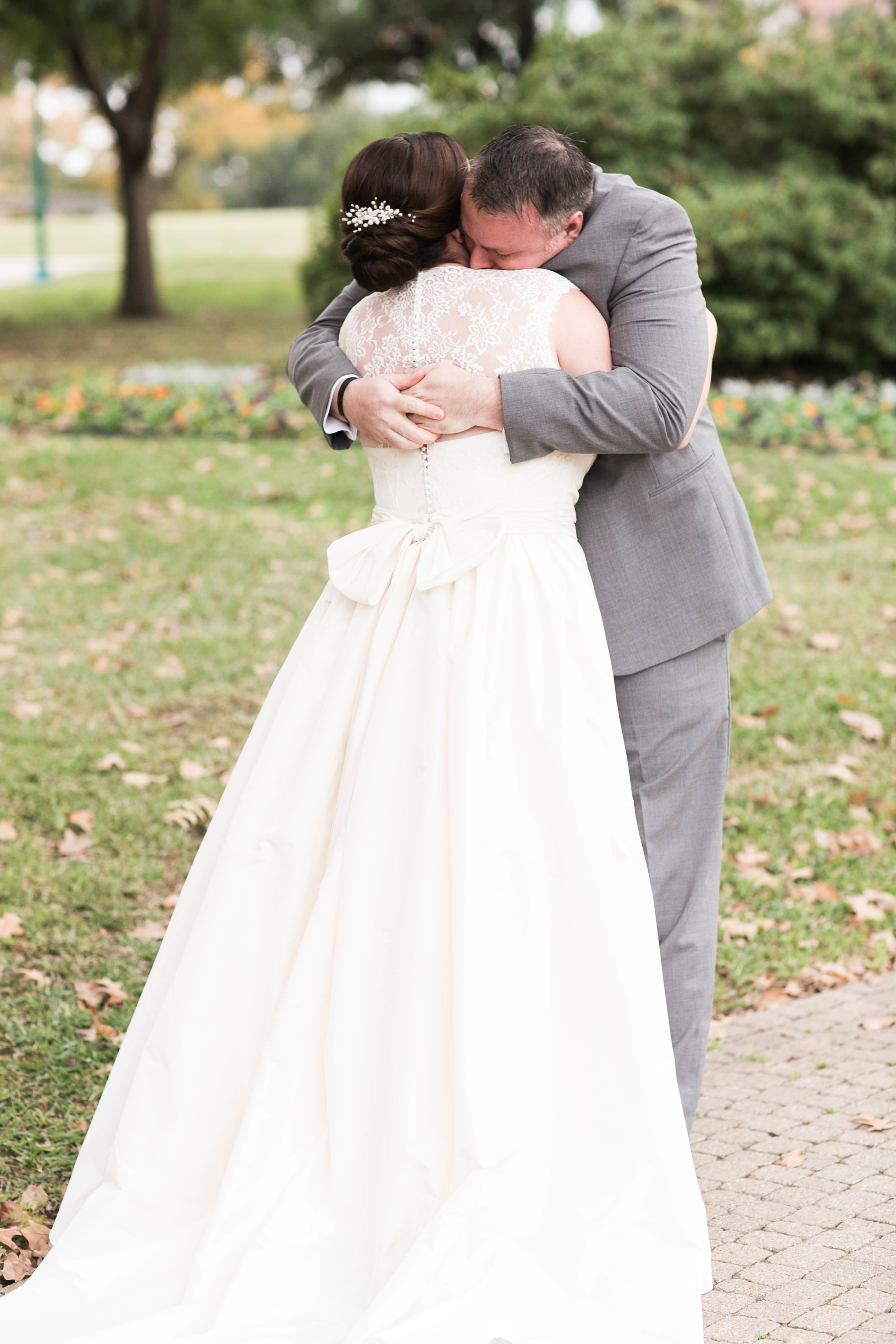 """The venue didn't have the best lighting, and I'm so glad I planned """"first look"""" and wedding party photos at a nearby park outside."""