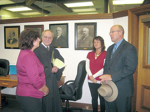 Judy Rensch of rural Corunna, left, talks with Steuben Circuit Court Judge Allen Wheat, Kristi Bachman, director of Northeastern Indiana CASA, and Steuben Superior Court Judge William Fee Monday afternoon in the Steuben Circuit Court. following her appointment to CASA.