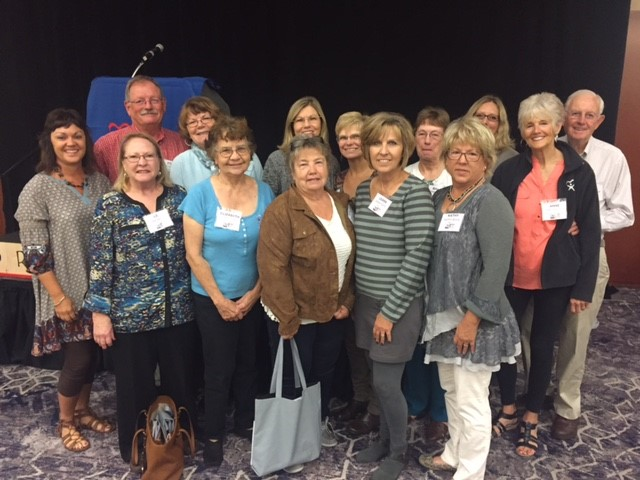 Myrlee is pictured, center in front row, with other CASA staff and volunteers at a recent conference.