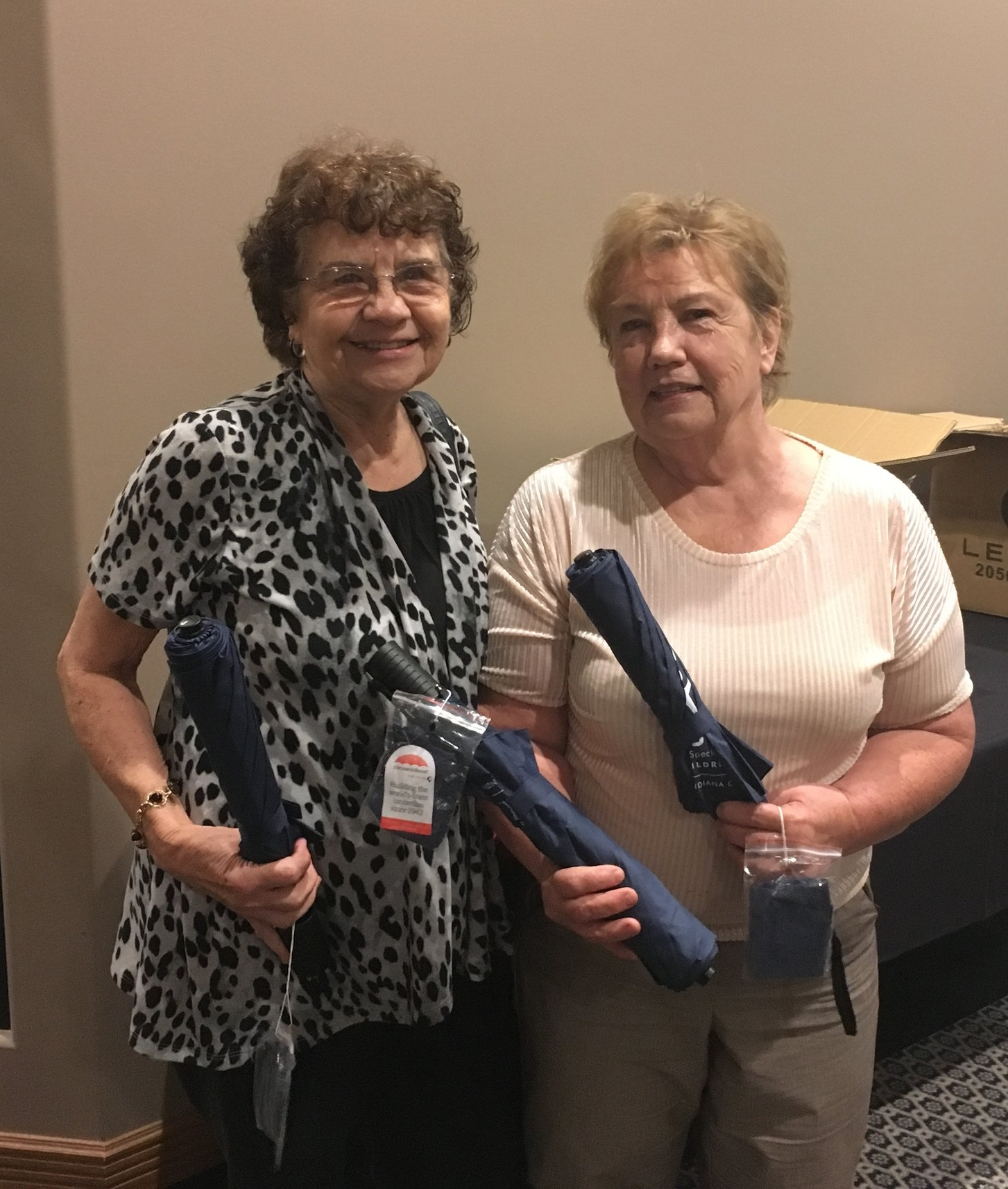 Pictured right, Myrlee works with other CASA volunteers to pass out appreciation gifts at a recent banquet honoring volunteers, board members and staff.