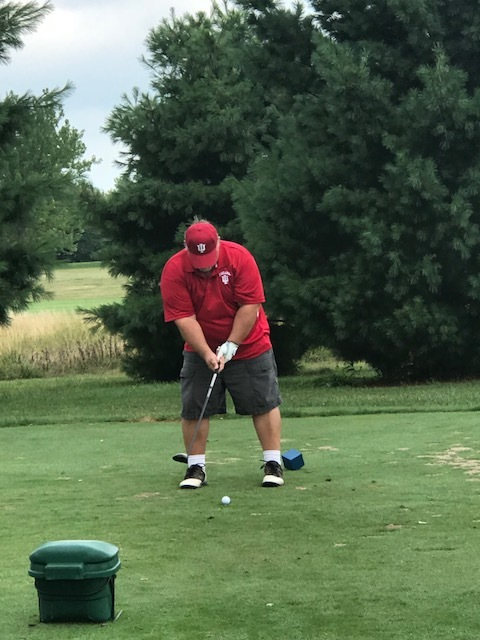 Stan Surfus tees up a shot at the golf outing hosted to benefit Northeastern Indiana CASA.