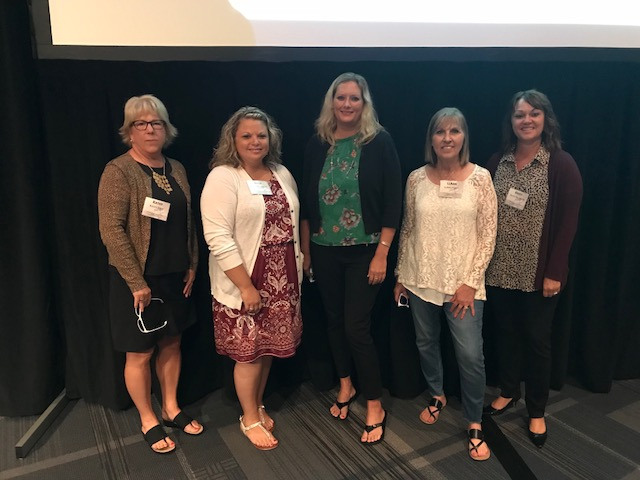Bachman, right, is pictured with her staff members at a recent conference.