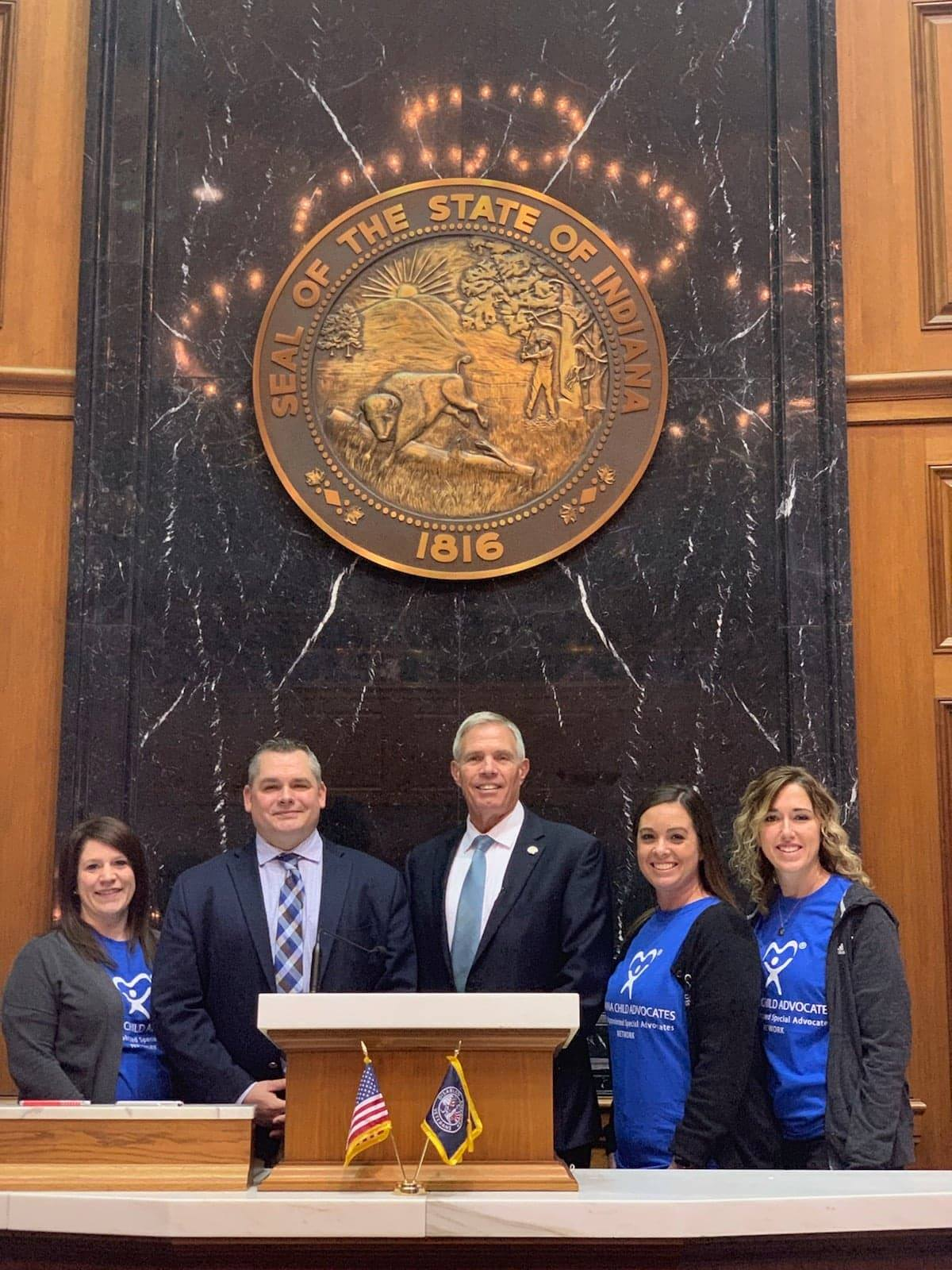 Brooke, Kirby and Abby are pictured with Representative Chris Judy and Representative David Abbott.