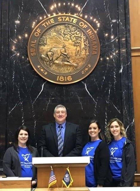 Brooke, Kirby and Abby are pictured with Representative Ben Smaltz.