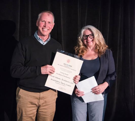 Austin Smith of Scott Simons Architects accepts the award for the Brattleboro Music Center.