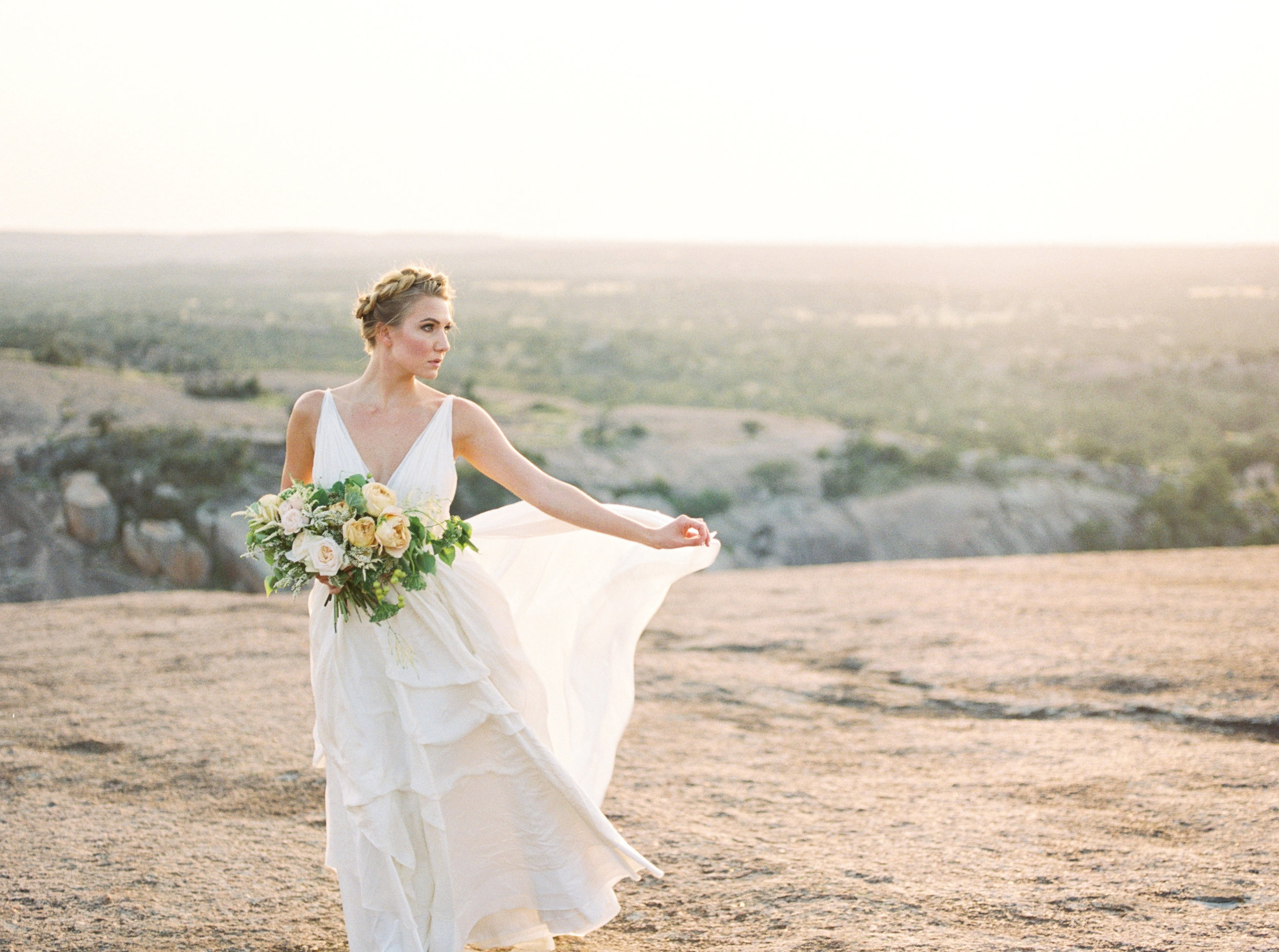 boho bride in enchanted rock for a fine art inspiration shoot