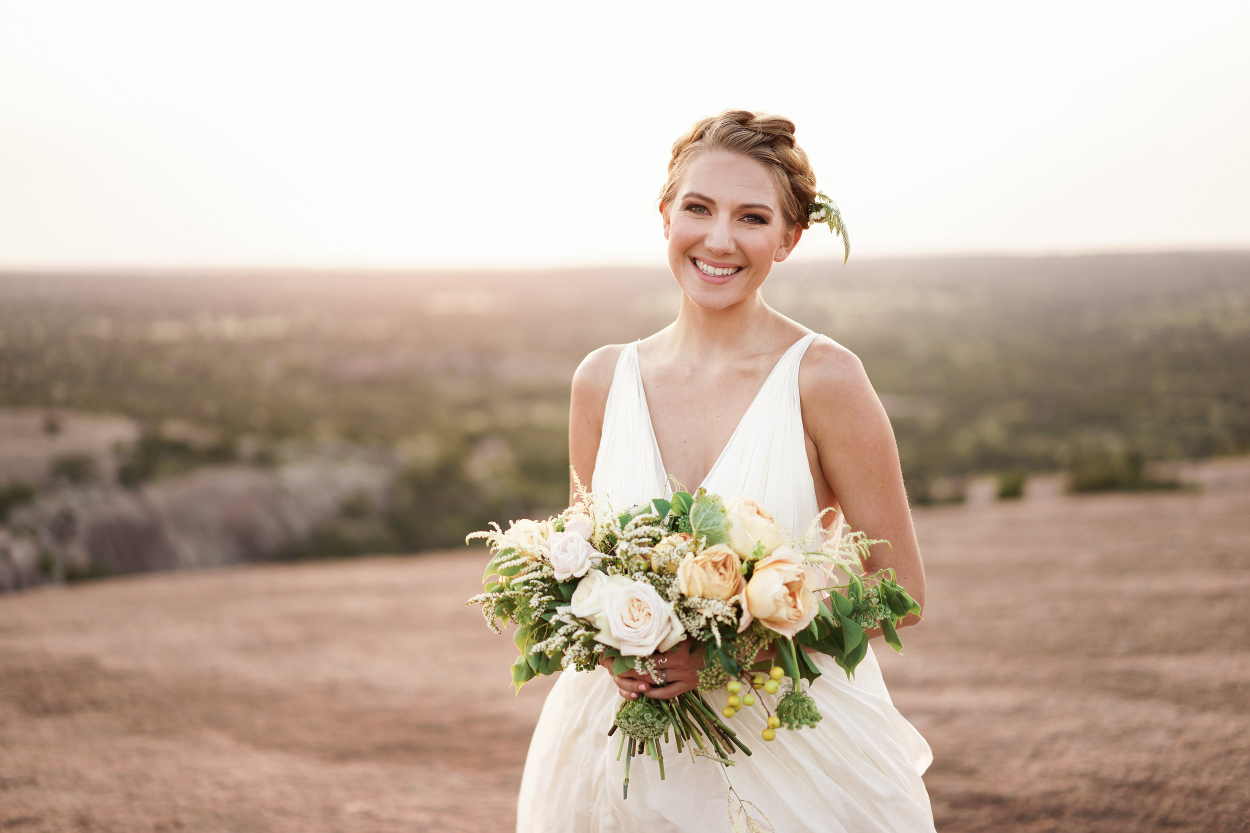 such a genuine smile and a beautiful bouquet by Austin florist clementine atx