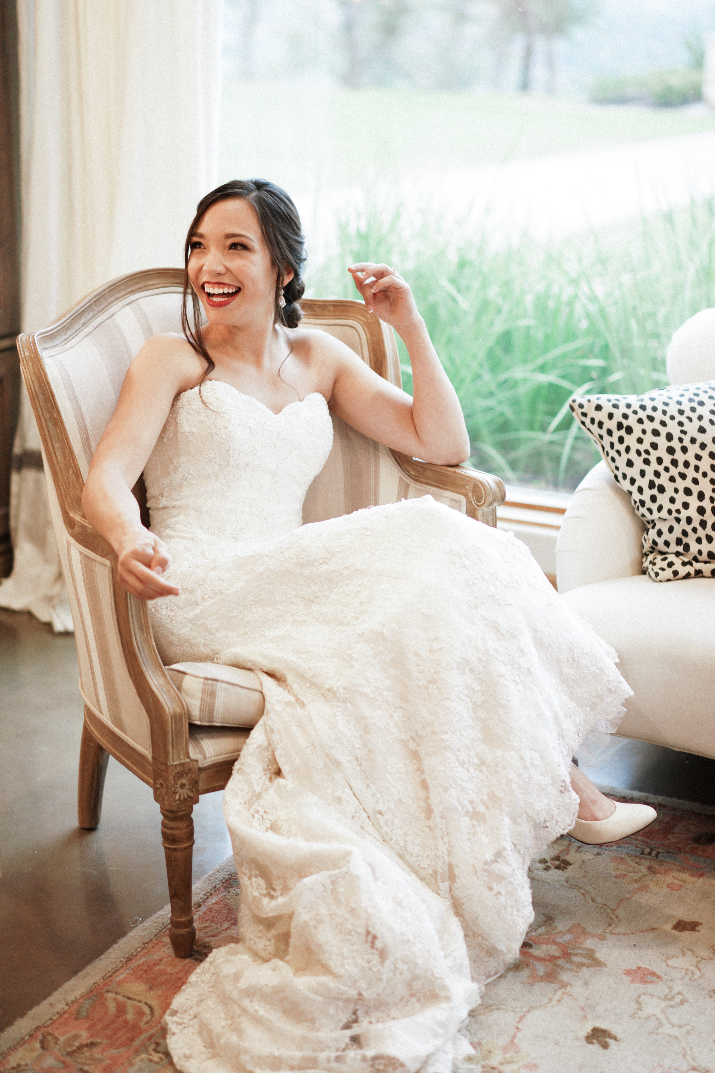 What a joyful bride in the beautiful bridal suite at Canyonwood Ridge!