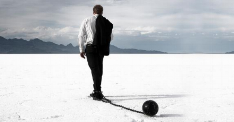 disappointed-businessman-dragging-ball-and-chain_573x300.jpg