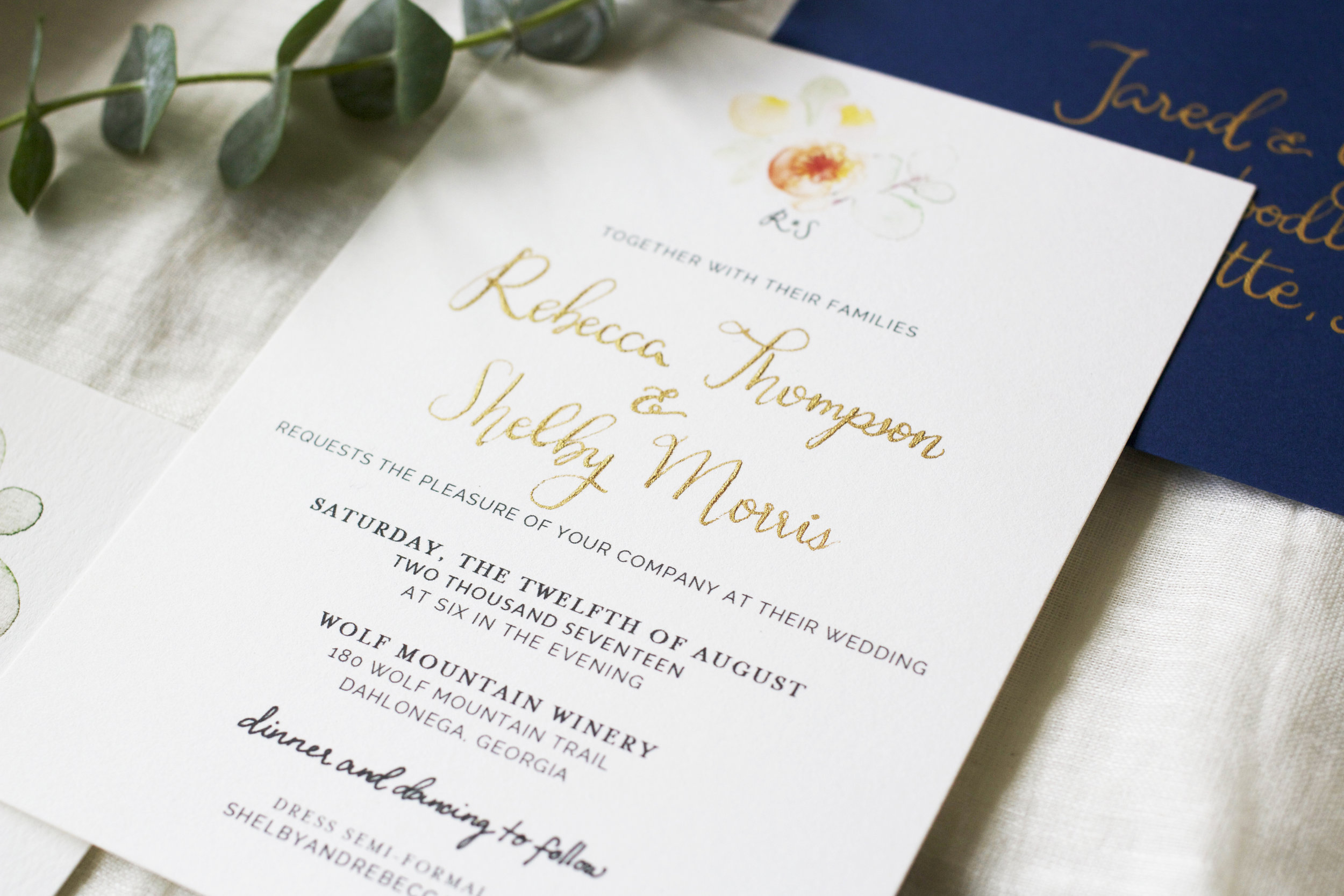 the raised ink effect - Spot pointed-pen calligraphy in copperplate gold. Paper is Crest Lettra, 300 GSM, in bright white.