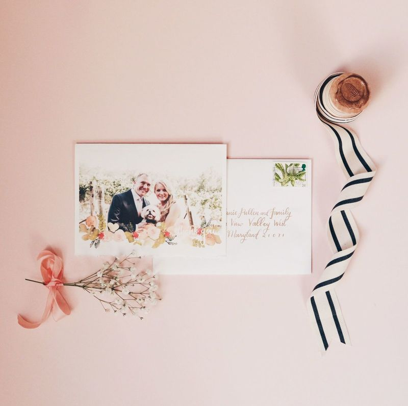 custom thank you cards - Using their wedding photo with a subtle bottom border of watercolor florals. Paper is deckled watercolor paper, to give texture.