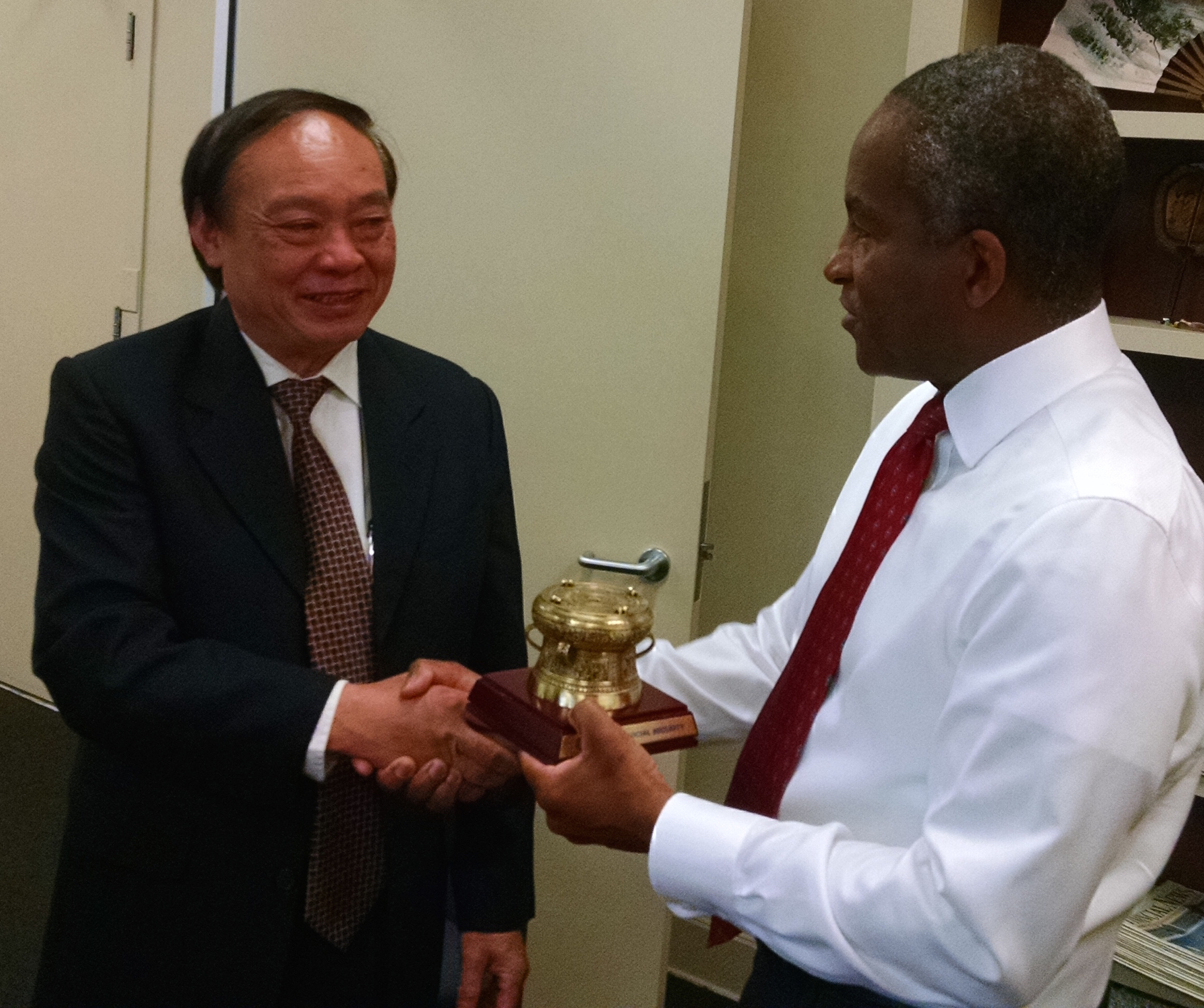 Mr. Nguyen Dinh Khuong, Deputy Director General, Vietnam Social Security (VSS) with PPI President Lionel Johnson at the PPI office in San Francisco, CA.