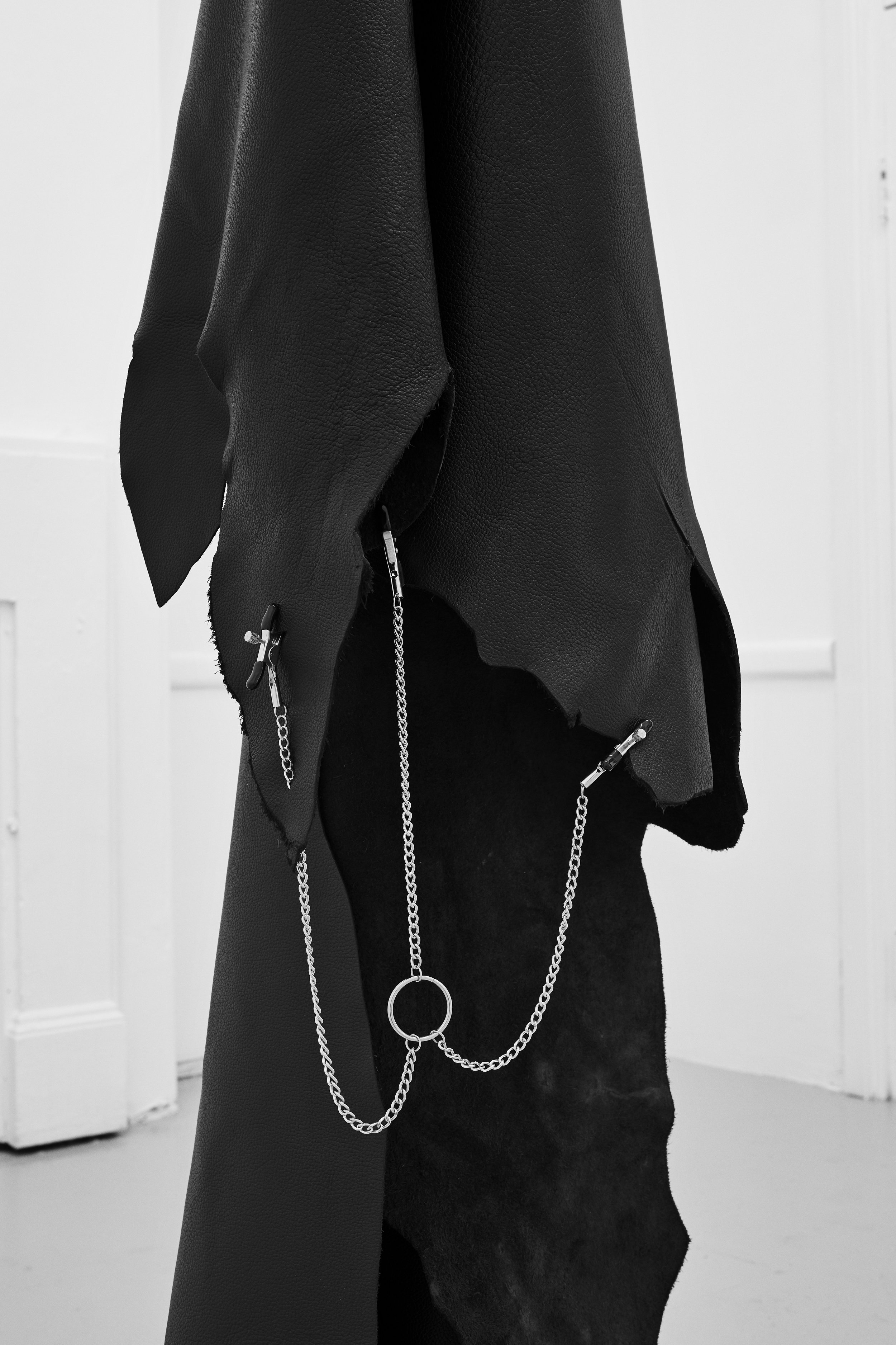 Untitled #5  from the series  Holding my breath , 2019, leather hide, chain, hook, cuffs, clamps, 350 x 60 x 60 cm