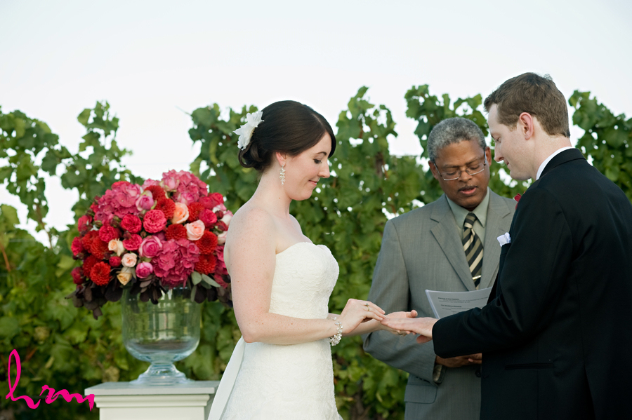 Toronto couple exchanging vows at their vineyard ceremony - red flower