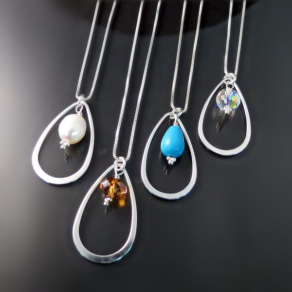 Pretty teardrop pendants with pearl, gemstone or Swarovski crystal.