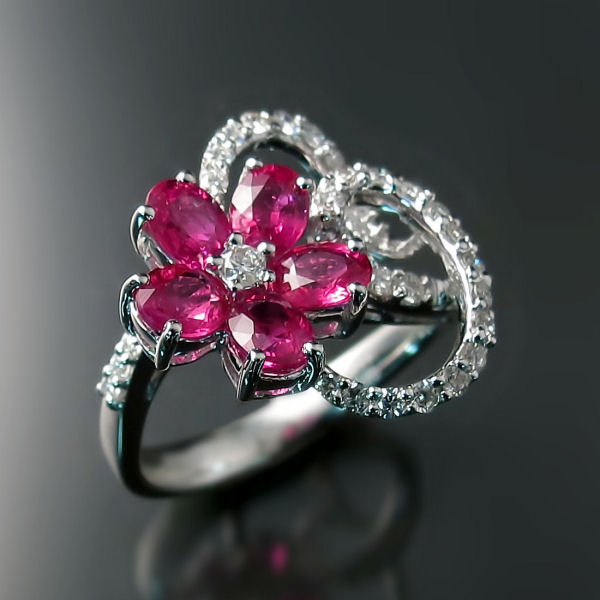 Ruby jewellery to ignite your imagination. Gorgeous oval rubies are showcased in a flower petal arrangement in this unique ruby ring with diamonds.   Click here to shop online.