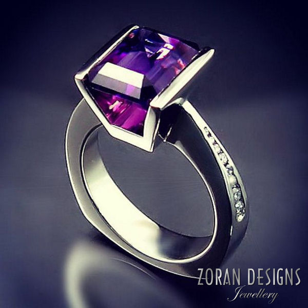 Custom designed ring in a modern setting with amethyst and diamonds