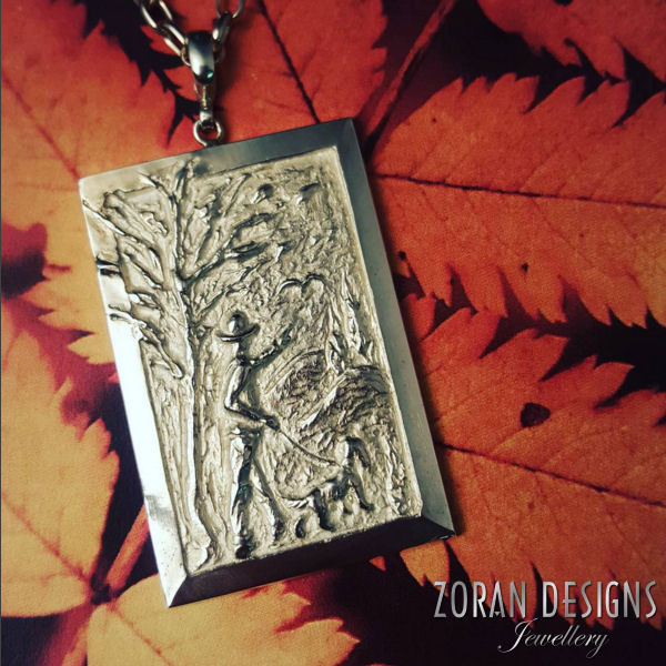 Talk about a unique jewellery design. This sculptural pendant looks like a textured painting. Fine wearable art for discerning jewellery lovers.
