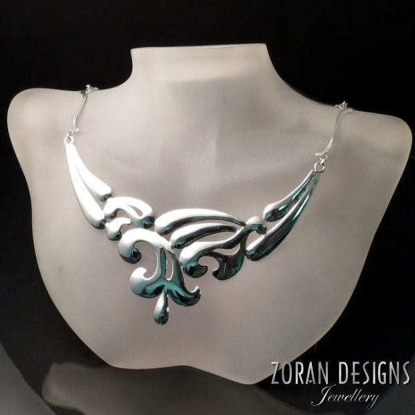 Beautiful silver statement necklace. Unique, modern design from the LUCID jewelry collection.