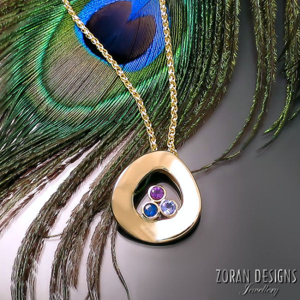 Modern Jewelry: gold pendant with blue sapphire, tanzanite, and amethyst gemstones