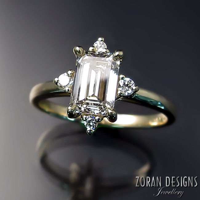 Engagement ring with emerald cut diamond