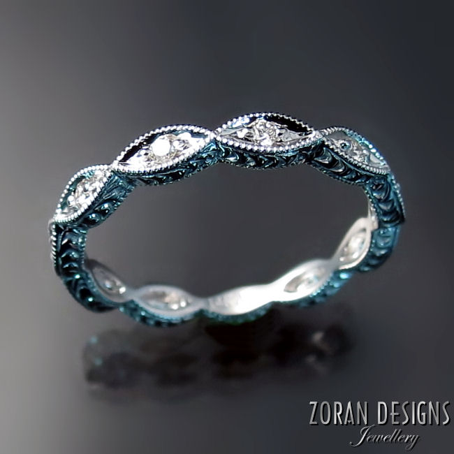 Wedding rings: scalloped band with diamonds