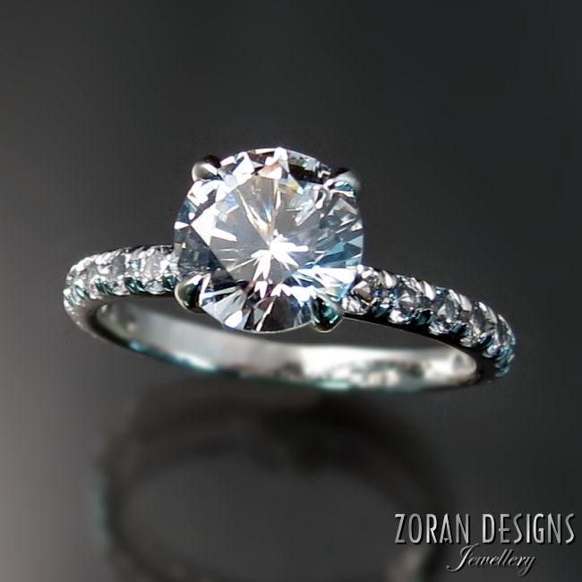 Platinum and white sapphire engagement ring