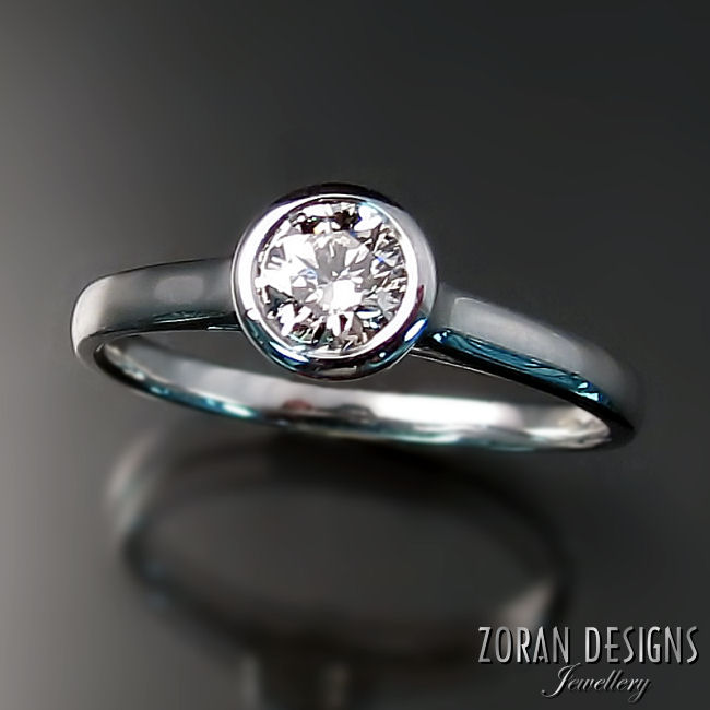 Modern, diamond solitaire engagement ring