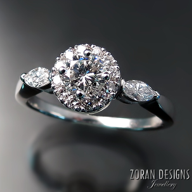 Custom diamond engagement ring with halo and marquise accents