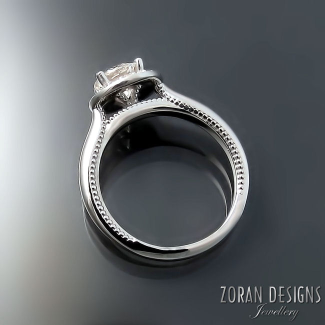Halo engagement ring with milgrain detailing