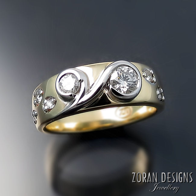 A fresh custom made ring in two tone gold made using stones from client's old jewellery