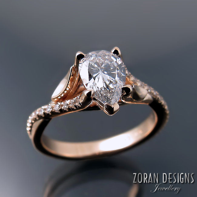 Leaf design engagement ring: rose gold with a pear cut centre