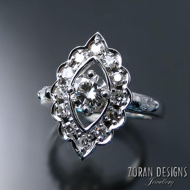 unique vintage inspired engagement ring design.jpg