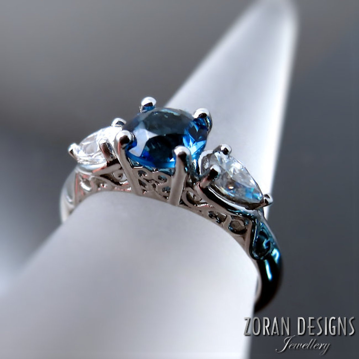 Custom made engagement ring with fancy gallery and vintage inspired design