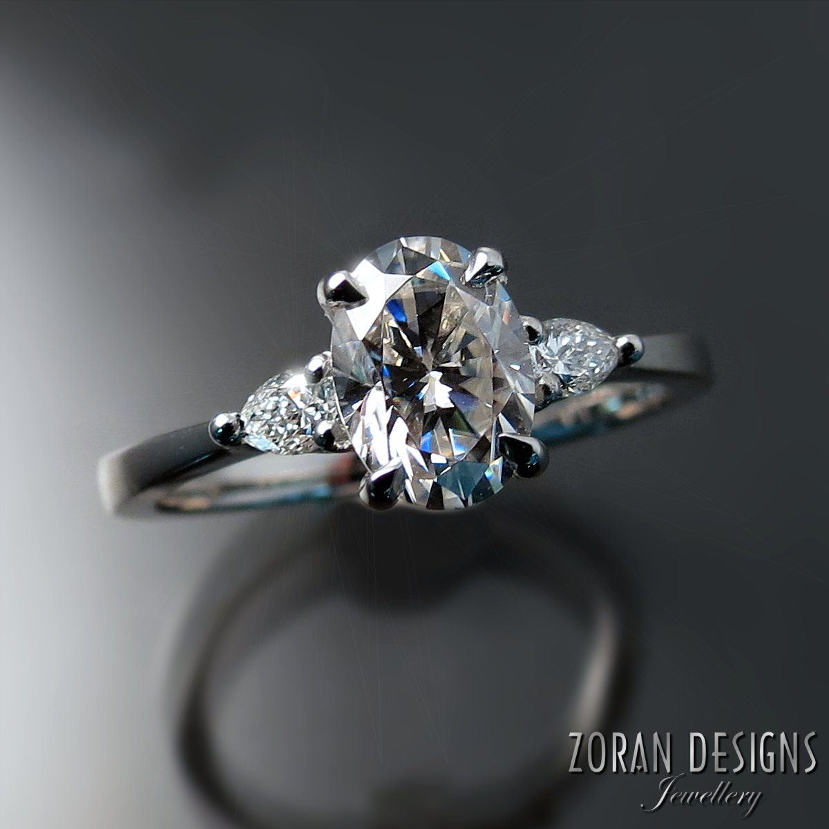 platinum pear accented engagement ring - Zoran Designs Jewellers Hamilton ON.jpg