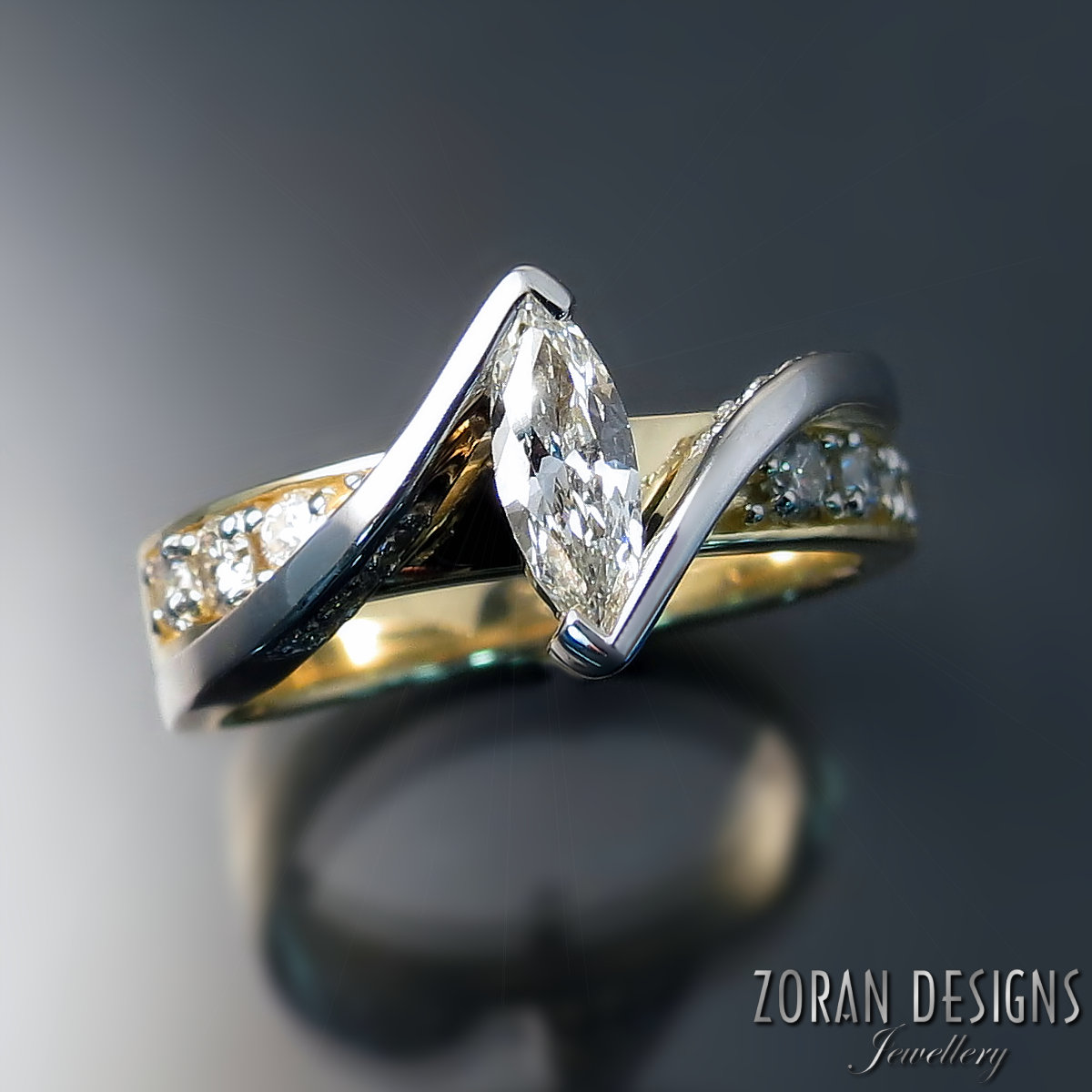 Custom made two tone gold ring designed around client's repurposed diamonds