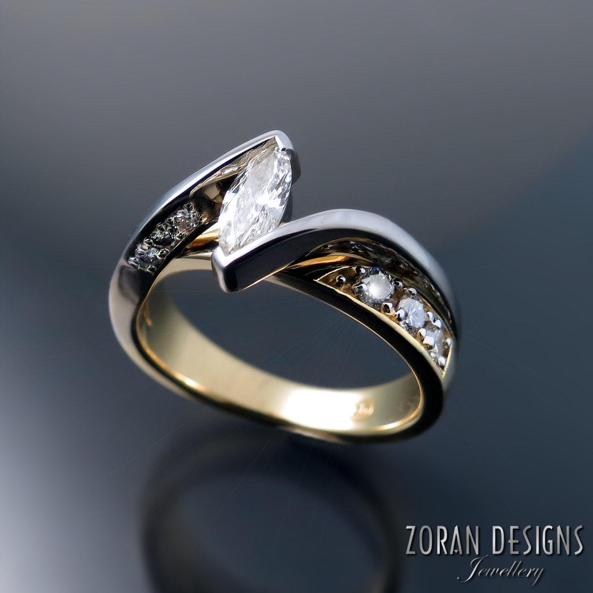 two tone gold engagement ring with marquise diamond.jpg