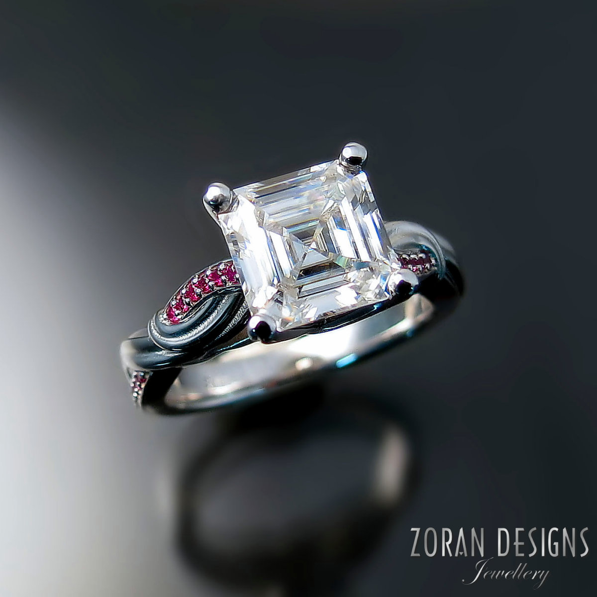moissanite-engagement-rings-unique-ruby-accented-design.jpg