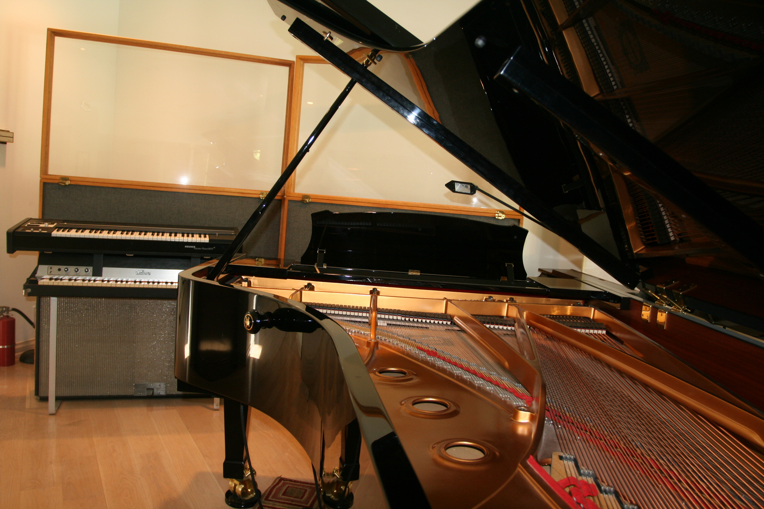 Real keys: A concert grand piano, Fender Rhodes, and Clavinet Pianet Duo