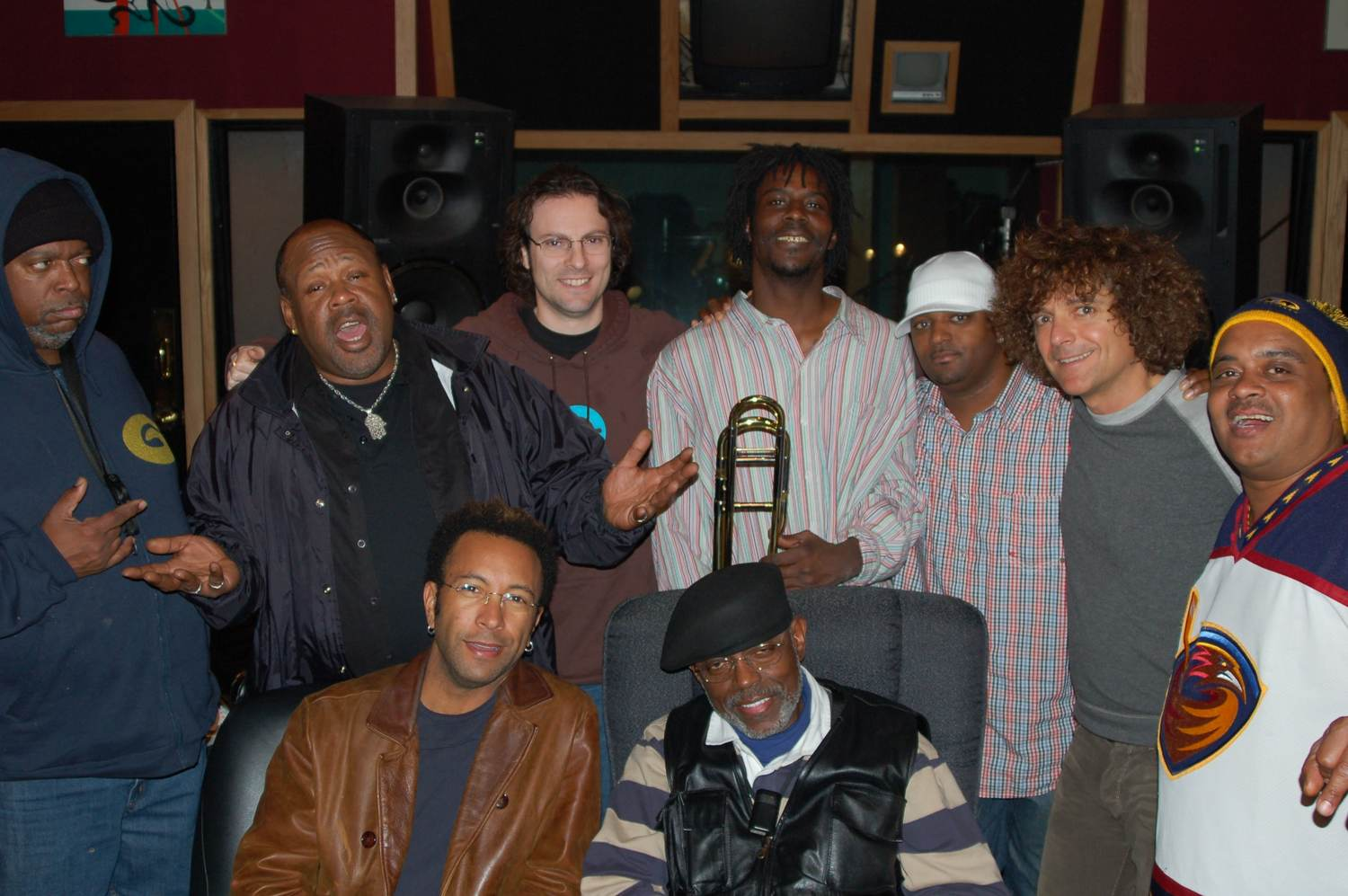 "Kevin Harris, Kirk Joseph, Shawn Amos, Clint Bennett, Roger Lewis, ""Peanut"" Andrews, Terrence Higgins, A. Marinelli, ""ET"" Towns. Dirty Dozen Brass Band ""What's Gong On"" Bismeaux Studio, Austin TX 2006"