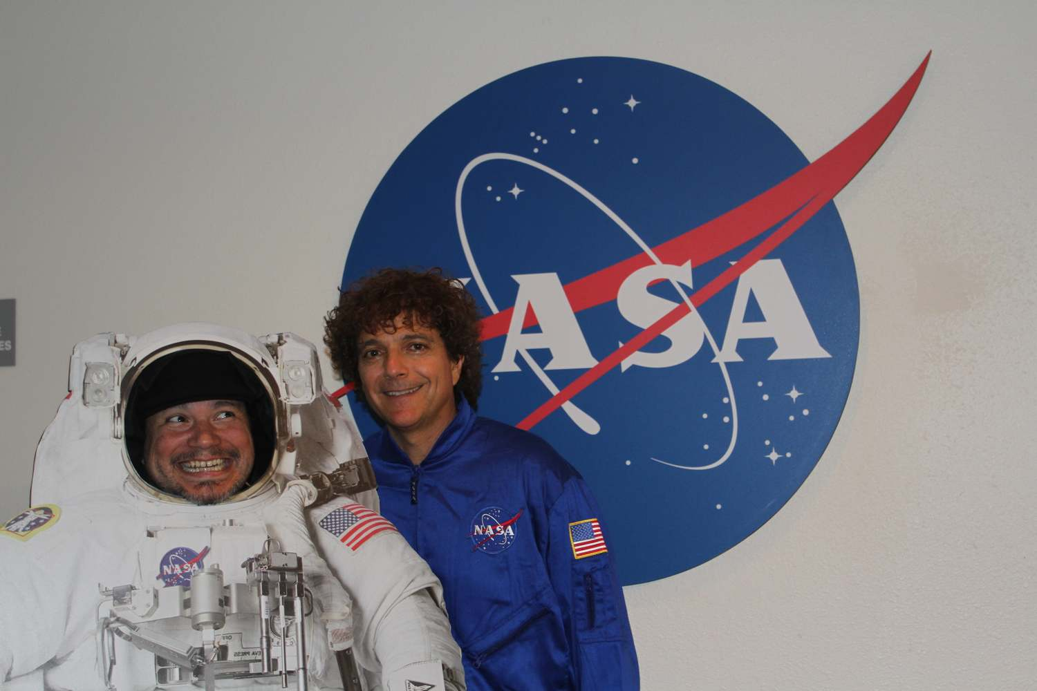 Asdru Sierra of Ozomatli (left) in an astronaut suit and Anthony Marinelli (right) in a flight-suit, at the NASA Ames, Conrad Foundation Spirit of Innovation Summit, Mountain View, CA, March, 2012.